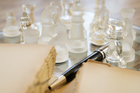 hardcovers: old book roller pen and glass chessboard Stock Photo