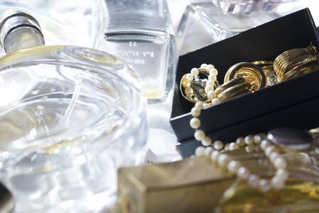 captivation: family jewels perfume bottles as concept of fashion and charm Stock Photo