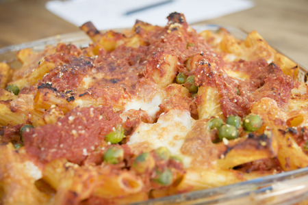 ed: baked and gratin�ed pasta stuffed with mozzarella peas ham and peas Stock Photo