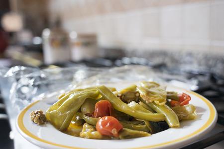 piatto peperonata composto di peperoni fritti in olio di oliva con pomodori, cipolle e aglio