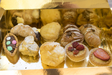 choux bun: assortment of stuffed pastries with cream or chocolate Stock Photo