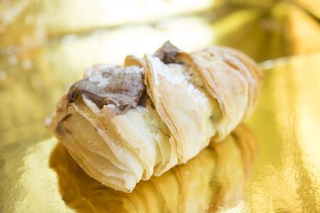 teacake: neapolitan sfogliatella stuffed with chocolate cream and covered with icing sugar