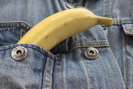 breast pocket: ripe banana in the breast pocket of a denim jacket