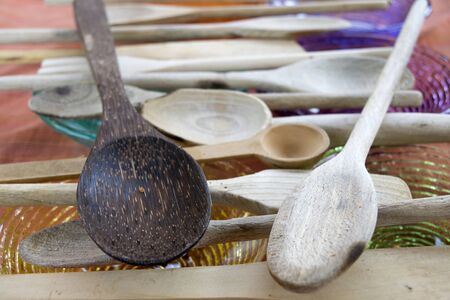 disposed: series of wooden spoons disposed in series