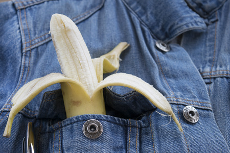 breast pocket: peeled banana in the breast pocket of a denim jacket