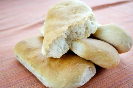 leftovers: leftovers of bread roll and  sandwich called schiacciate Stock Photo