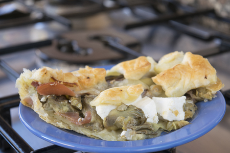 cured: leftovers of homemade savoury tart filled with cured ham mozzarella and artichokes