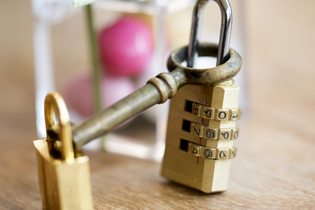 antique keyhole: modern combination padlock with normal padlock and old key Stock Photo