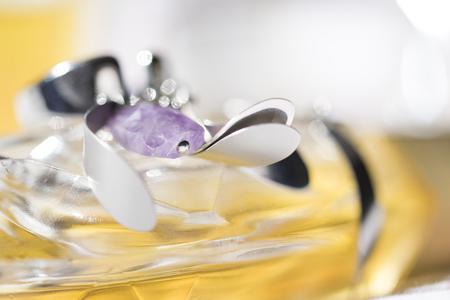 costume jewellery: earring of costume jewellery on a perfume bottle