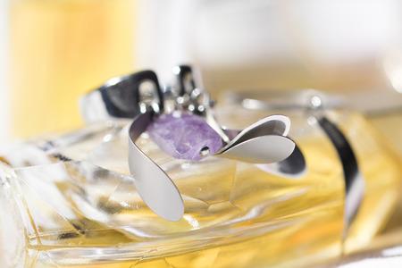 earring of costume jewellery on a perfume bottle