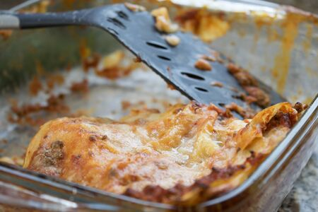 leftovers: leftovers of bolognese style lasagne in a glass bowl