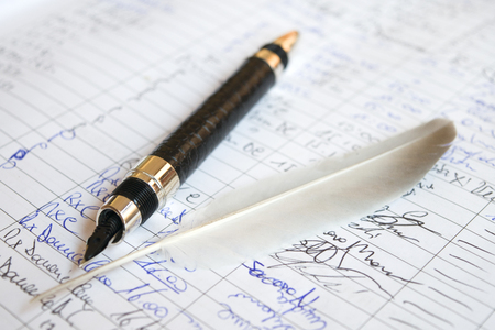 manuscript: longhand on an old manuscript with a plume and a fountain pen