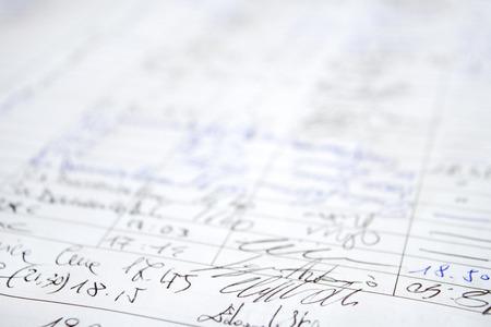 pluma de escribir antigua: ancient hand written document with numbers and written