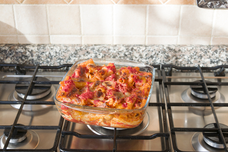 baked meat: baked pasta with bolognese sauce and mozzarella Stock Photo