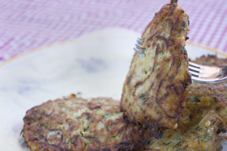 fritters: fried zucchini fritters on absorbent paper