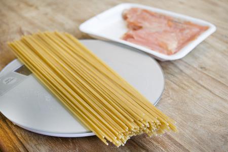 stovetop: preparing wholemeal spaghetti with smoked salmon and tomato sauce