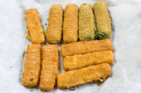 defrost: vegetable and fish fingers in a crisp  breadcrumb coating Stock Photo