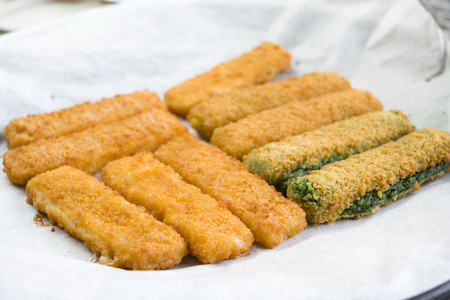 coating: vegetable and fish fingers in a crisp  breadcrumb coating Stock Photo