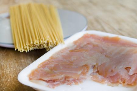 preparing wholemeal spaghetti with smoked salmon