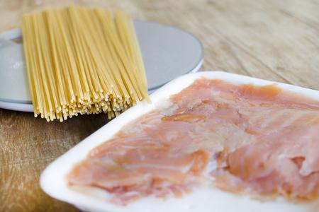 stovetop: preparing wholemeal spaghetti with smoked salmon