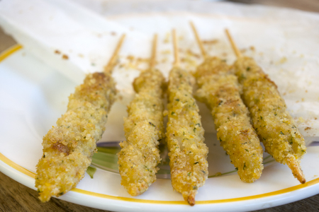 fish skewers made with  mollusks cut in chunks and pierced by a skewer Stock Photo