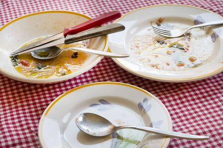 leavings: end the meal .some dirty dishes with sauce smeared on some plates Stock Photo