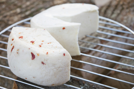 pecorino young cheese made from ewes milk and flavored with red chilli cutter