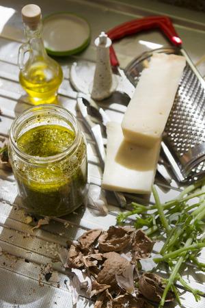 genoese: fresh ingredients and tools to prepare genoese basil pesto sauce