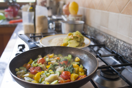 preparation of summer ratatouille with assortment of vegetable