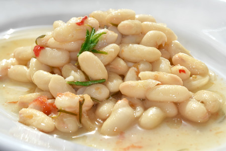 cannellini beans soup with fresh tomato Archivio Fotografico
