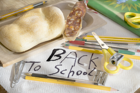 scholastic: concept of back to school with some scholastic tools and a snack