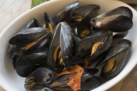 peppered: mussels soup with tomatoes hot pepper and parsley Stock Photo