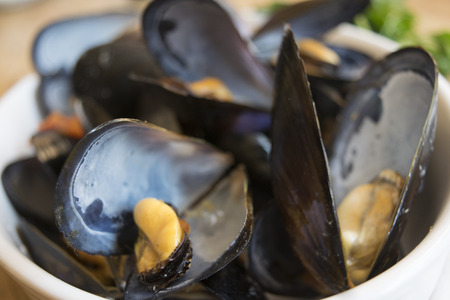 mussels soup with tomatoes hot pepper and parsley Stock Photo