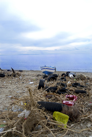 environmental pollution. A beach in Calabria with wastes and polluting material