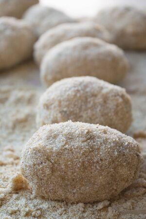 breadcrumbs: preparation of sicilian arancine with breadcrumbs on a paper