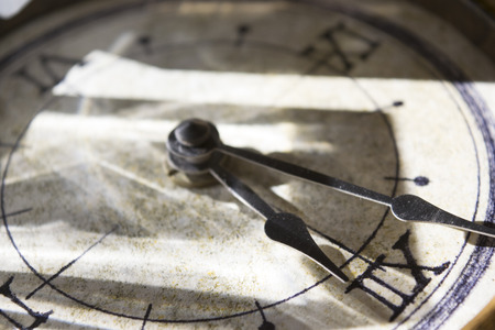 numers: lights and shadows on an old clock with roman numbers