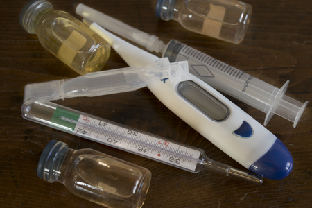 human body substance: treatment of flu illness with medicines and thermometer