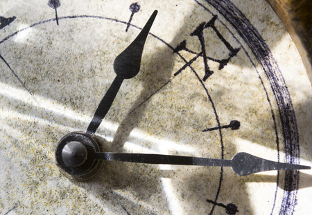 numers: hands of a old clock with roman numbers