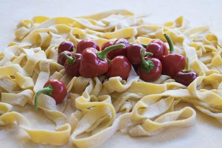 fettuccine: hot chili peppers on some handmade fettuccine Stock Photo
