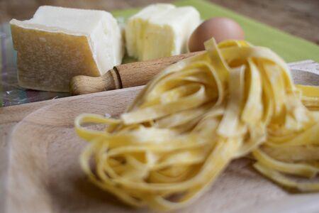 fettuccine: ingredients and utensils to prepare fettuccine alfredo