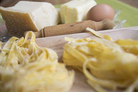 fettuccine: ingredients and utensils for fettuccine Alfredo
