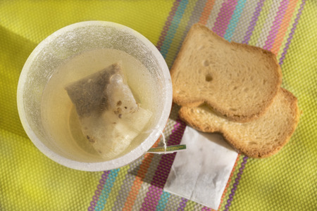 melba: green tea filtre in infusion  and melba toast