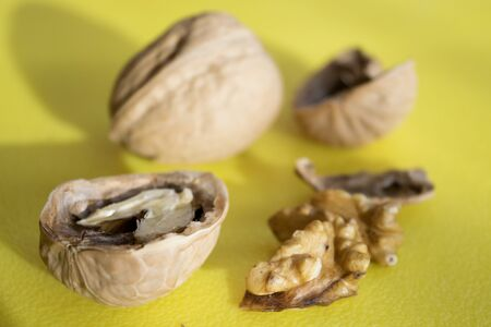 leftovers: shelled kernels of walnuts and nutshells Stock Photo