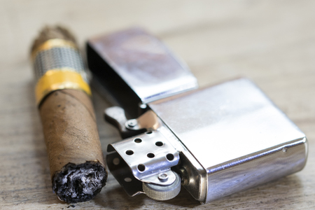 Havana cigar just smoked and petrol metallic lighter