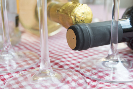 bottleneck of an ageing red wine through the stem of the flute Stock Photo