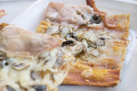 leftovers: pieces of pizza with cooked ham black olives anf mushrooms