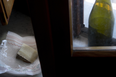 sardinian pecorino illumined from light of a window