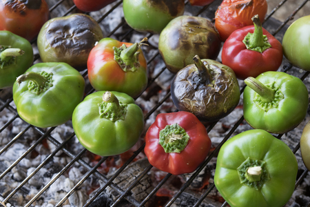 peppers and tomatoes grilled cooked on the embers