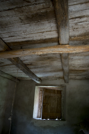 lintel: ancient wooden ceiling of an old hut