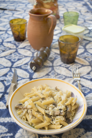pennette pasta at the champignon mushrooms and cauliflowers Stok Fotoğraf - 89514420